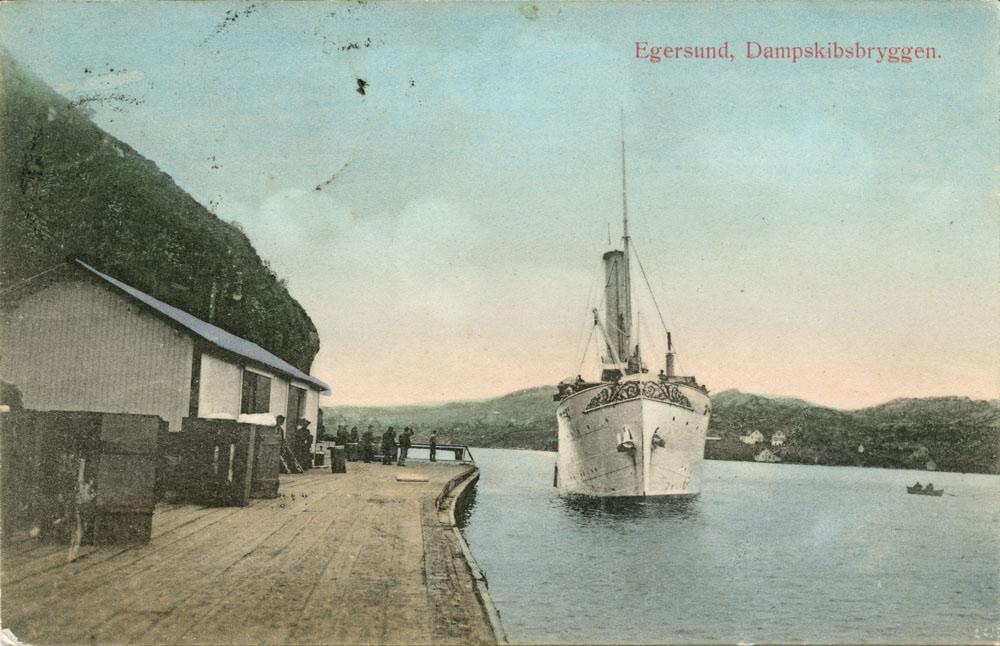 Postkort med bilde av dampskipsbryggen i Egersund